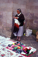 Woman selling her embroidery and yarn in the market in Angangueo, Michoacan, Mexico. Angangueo is the starting point for visits to the El Rosario and Sierra Chincua monarch butterfly sanctuaries.