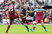 Issa Diop of West Ham United, Gabriel Jesus of Manchester City and Ryan Fredericks of West Ham United during the Premier League match between West Ham United and Manchester City at the London Stadium, London, England on 10 August 2019. Photo by David Horn.