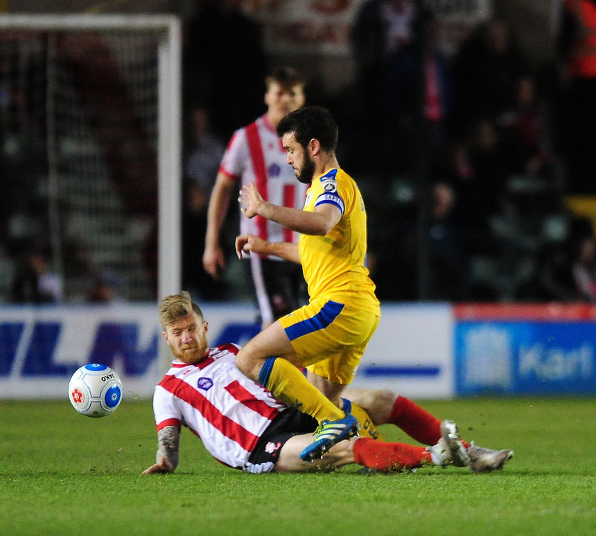 Chester's Luke George is fouled by Lincoln City's Alan Power who was shown a red card for the challenge<br /> <br /> Photographer Chris Vaughan/CameraSport<br /> <br /> Vanarama National League - Lincoln City v Chester - Tuesday 11th April 2017 - Sincil Bank - Lincoln<br /> <br /> World Copyright &copy; 2017 CameraSport. All rights reserved. 43 Linden Ave. Countesthorpe. Leicester. England. LE8 5PG - Tel: +44 (0) 116 277 4147 - admin@camerasport.com - www.camerasport.com