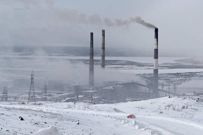 Chimneys from the smelters in the town of Nikel emit sulphur dioxide and other pollutants into the atmosphere. Kola Peninsula. NW Russia.