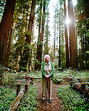 USA, California, 103 year old woman standing in the redwood trees