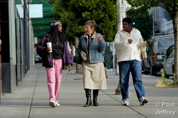 The Rev. Pat Simpson (center), a former pastor of the Church of Mary Magdalene, walks with two homeless women in Seattle. The woman with the long hair is Jolandia Jutte and the woman with the short hair is Lucinda Pogue.