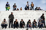 Men and boys listening from the ledge of a wall at Newroz, the Kurdish New Year celebration, in Viranşehir, Turkey, March 18, 2015. Newroz, or Nowruz, is an ancient holiday celebrated by a multitude of ethnic groups across Iran, Central Asia, and the Caucuses, and ushers in the first day of Spring, March 21. For Kurds, Newroz is a means of political and cultural expression, featuring Kurdish politicians, activists, and musicians, and has become a manifestation of Kurdish identity. In Turkey, the celebrations begin a few days before the Vernal Equinox, culminating in a huge gathering in the heart of Turkey's Kurdish population, the southeastern city of Diyarbakir. This year, PKK founder Abdullah Öcalan, who despite serving a life sentence for treason still enjoys widespread influence among Kurds, sent a letter that was read at Newroz in Diyarbakir, calling for an end to the PKK's armed struggle against the Turkish state.