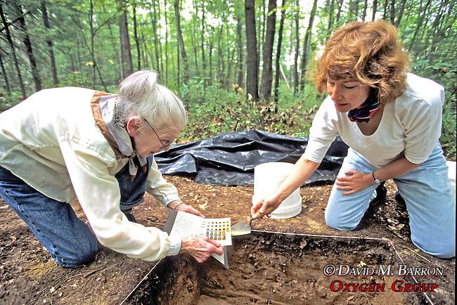 Margaret Biggs & Regina Salice Checking Color Of Soil Against Color Chart