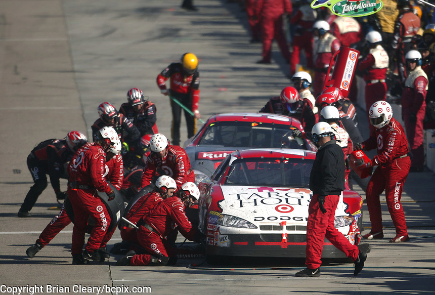 The cars of Casey Mears and Kurt Busch make pit stops for repairs after the two drivers made contact on the track during  the Pop Secret 400 NASCAR Winston Cup race at Rockingham, NC on Sunday, November 9, 2003. (Photo by Brian Cleary)