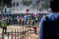 People watching the clashes between protesters and police.<br /> Siege at Polytechnic University.<br /> Police surround the university campus after pro-democratic protesters blocked the cross-harbour tunnel and the major road outside the campus.<br /> Hong Kong protest continuous on its sixth months. A citywide strike called for started on Monday 11 November, 2019 which brought parts of Hong Kong to halt as MTR stations closed and multiple roadblocks were erected. Hong kong, 17.11.2019