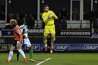 Yeovil Town keeper Artur Krysiak claims the ball during the Sky Bet League 2 match between Luton Town and Yeovil Town at Kenilworth Road, Luton, England on 2 February 2016. Photo by Liam Smith.