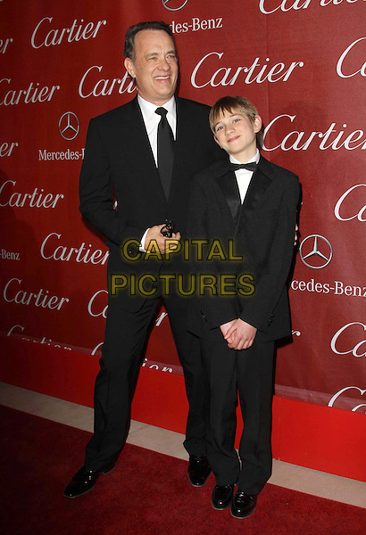 Tom Hanks and Thomas Horn.At The 23rd Annual Palm Springs International Film Festival Awards Gala Held At The Palm Springs Convention Center, Palm Springs, California, USA,.7th January 2012..arrivals full length black suit tie arm around.CAP/ADM/KB.©Kevan Brooks/AdMedia/Capital Pictures.