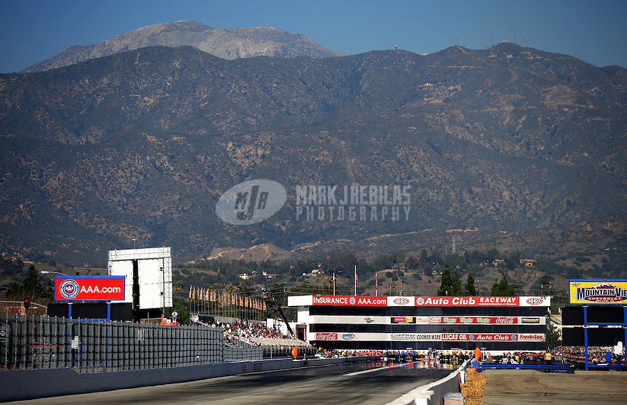 Feb. 10, 2012; Pomona, CA, USA; Mount Baldy is seen behind Auto Club Raceway at Pomona during NHRA qualifying at the Winternationals. Mandatory Credit: Mark J. Rebilas-