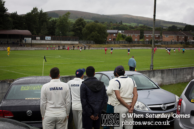 Vale of Leven 3 Ashfield 4, 03/09/2016. Millburn Park, West of Scotland League Central District Second Division. Cricketers from the neighbouring club watching the action during the second-half action at Millburn Park, Alexandria, as Vale of Leven (in blue) hosted Ashfield in a West of Scotland League Central District Second Division Junior fixture. Vale of Leven were one of the founder members of the Scottish League in 1890 and remained part of the SFA and League structure until 1929 when the original club folded, only to be resurrected as a member of the Scottish Junior Football Association after World War II. They lost the match to Ashfield by 4-3, having led 3-1 with 10 minutes remaining. Photo by Colin McPherson.