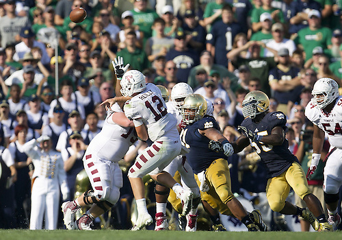 August 31, 2013:  Notre Dame defensive lineman Sheldon Day (91) pressures Temple quarterback Connor Reilly (12) during NCAA Football game action between the Notre Dame Fighting Irish and the Temple Owls at Notre Dame Stadium in South Bend, Indiana.  Notre Dame defeated Temple 28-6.