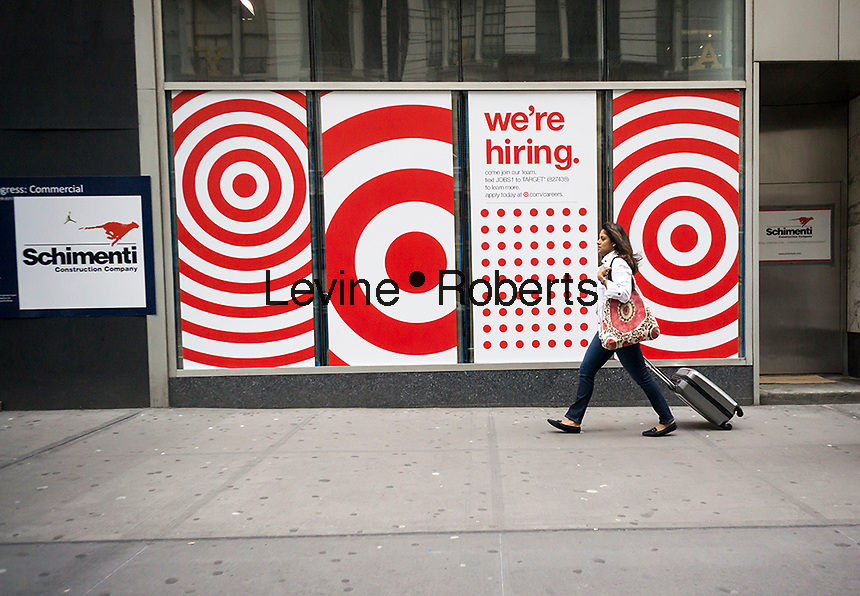 A sign on the exterior of an under construction Target store in the Herald Square shopping district in New York on Monday, May 29, 2017 encourages prospective employees to apply for jobs in the retail industry at Target. This store when opened will be across the street from Macy's. (© Richard B. Levine)