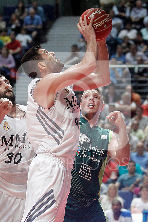 Real Madrid's Felipe Reyes (l) and Unicaja's Vladimir Stimac during Liga Endesa ACB Semifinal match.June 6,2014. (ALTERPHOTOS/Acero)