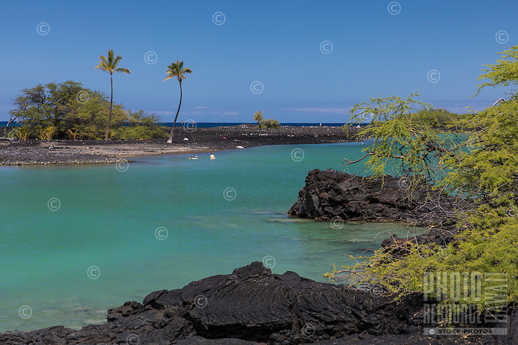 Two swimmers at Kiholo Bay, Kona, Big Island.