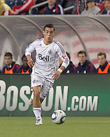 Vancouver Whitecaps FC midfielder Russell Teibert (31) brings the ball forward. In a Major League Soccer (MLS) match, the New England Revolution defeated the Vancouver Whitecaps FC, 1-0, at Gillette Stadium on May14, 2011.