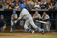 UCLA outfielder Eric Filia (4) follows through on his swing against the Mississippi State Bulldogs during Game 1 of the 2013 Men's College World Series Final on June 24, 2013 at TD Ameritrade Park in Omaha, Nebraska. The Bruins defeated the Bulldogs 2-1, taking a 1-0 lead in the best of 3 series. (Andrew Woolley/Four Seam Images)