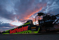 Oct 28, 2016; Las Vegas, NV, USA; The dragster of NHRA top fuel driver J.R. Todd is towed back to the pits with the sunset behind during qualifying for the Toyota Nationals at The Strip at Las Vegas Motor Speedway. Mandatory Credit: Mark J. Rebilas-USA TODAY Sports