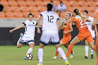 Houston, TX - Saturday July 08, 2017: Meghan Klingenberg takes a shot at the Houston goal during a regular season National Women's Soccer League (NWSL) match between the Houston Dash and the Portland Thorns FC at BBVA Compass Stadium.