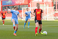 Bridgeview, IL, USA - Saturday, April 23, 2016: Western New York Flash midfielder Samantha Mewis (5) defended by Chicago Red Stars midfielder Alyssa Mautz (4) during a regular season National Women's Soccer League match between the Chicago Red Stars and the Western New York Flash at Toyota Park. Chicago won 1-0.