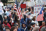 CROWD WAVES U.S FLAGS and BANNERS in SUPPORT of PRESIDENT GEORGE BUSH Jr.s DECISION to ATTACK IRAQ