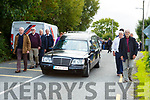 Denis McMahon coffin leaving Ballyhar after his funeral mass on Monday morning flanked by a guard of honor by musicians from Killarney Comhaltas