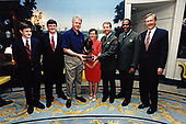 United States President Bill Clinton presents the Harry M. Yount Ranger of the Year Award to Mike Anderson of Cape Hatteras National Seashore, North Carolina in the Diplomatic Reception Room of the White House in Washington, DC on April 22, 1998.  Pictured from left to right: Richard Anderson, Michael Anderson, President Clinton, Gale Anderson, Mike Anderson, Robert Stanton, and US Secretary of the Interior Bruce Babbitt.<br /> Mandatory Credit: Ralph Alswang / White House via CNP