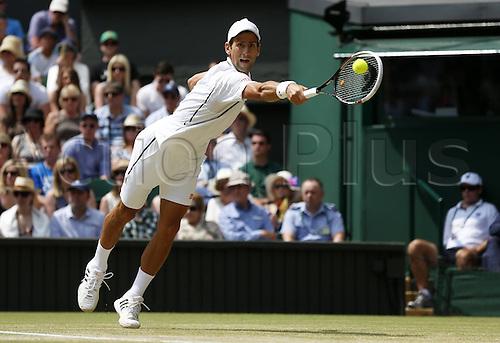 05.07.2013. Wimbledon, London, England.  Novak Djokovic of Serbia plays Martin Del Potro (Arg) in the mens singles semi-finals match