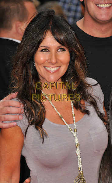 Linda Lusardi.The UK premiere of 'Katy Perry: Part Of Me'  at the Empire cinema, Leicester Square, London, England..July 3rd, 2012.headshot portrait grey gray white necklace rope knotted gold.CAP/WIZ.© Wizard/Capital Pictures.