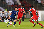 Minamino Takumi of Japan (L) is tackled by Harib Al Saadi (R) and Ahmed Al Mahaijri of Oman during the AFC Asian Cup UAE 2019 Group F match between Oman (OMA) and Japan (JPN) at Zayed Sports City Stadium on 13 January 2019 in Abu Dhabi, United Arab Emirates. Photo by Marcio Rodrigo Machado / Power Sport Images