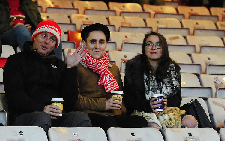 Lincoln City fans watch their team in action<br /> <br /> Photographer Andrew Vaughan/CameraSport<br /> <br /> The EFL Sky Bet League Two - Lincoln City v Newport County - Saturday 22nd December 201 - Sincil Bank - Lincoln<br /> <br /> World Copyright © 2018 CameraSport. All rights reserved. 43 Linden Ave. Countesthorpe. Leicester. England. LE8 5PG - Tel: +44 (0) 116 277 4147 - admin@camerasport.com - www.camerasport.com