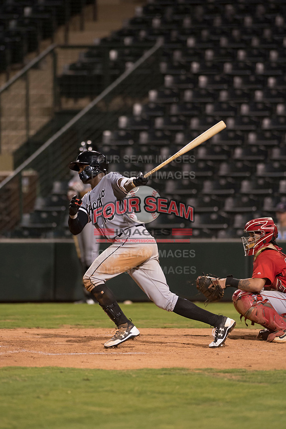 Center fielder Luis Robert (15), on rehab assignment with the AZL White Sox, hits a double during an Arizona League game against the AZL Angels at Tempe Diablo Stadium on August 3, 2018 in Tempe, Arizona. The AZL White Sox defeated the AZL Angels 6-4. (Zachary Lucy/Four Seam Images)