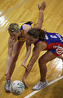 Pulse centre Camilla Lees (left) and Mystics centre Temepara George compete for the ball during the ANZ Netball Championship match between the Central Pulse and Northern Mystics, TSB Bank Arena, Wellington, New Zealand on Monday, 4 May 2009. Photo: Dave Lintott / lintottphoto.co.nz