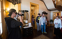 NWA Democrat-Gazette/BEN GOFF @NWABENGOFF<br /> Evan Keith (left), an Arkansas Arts Adademy student, films Friday, March 2, 2018, as students from Arkansas Arts Academy film for a project at the Peel Mansion Museum and Heritage Gardens in Bentonville. High school students from the school's audio visual class and theater program are collaborating to produce a 15 minute short film about the Peel Mansion as an entry for the Arkansas Educational Television Network's Student Selects competition for young filmmakers. The film includes interviews with people involved in the museum as well as vignettes of moments in the 1875 home's history with theater students portraying historical figures.