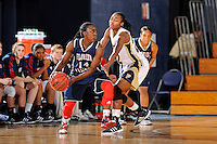 21 January 2012:  FIU guard Jerica Coley (22) defends FAU guard Latavia Dempsey (14) in the second half as the Florida Atlantic University Owls defeated the FIU Golden Panthers, 50-49, at the U.S. Century Bank Arena in Miami, Florida.