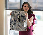Designer Olivia Osborne shows a rug sample during Reno Magazine's Home Decor Workshop at Aspen Leaf Interiors Studio in Reno on Saturday, March 24, 2018.
