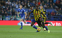 Watford's Isaac Success shields the ball from Leicester City's Wes Morgan <br /> <br /> Photographer Stephen White/CameraSport<br /> <br /> The Premier League - Leicester City v Watford - Saturday 1st December 2018 - King Power Stadium - Leicester<br /> <br /> World Copyright © 2018 CameraSport. All rights reserved. 43 Linden Ave. Countesthorpe. Leicester. England. LE8 5PG - Tel: +44 (0) 116 277 4147 - admin@camerasport.com - www.camerasport.com