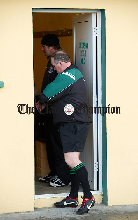 Referee Michael Talty checks in with Doonbeg manager Ciaran O Neill and his men outside the dressing rooms at Kilmihil in advance of the county football quarter final which didn't take place because Cooraclare didn't turn up and Doonbeg themselves eventually didn't take to the field. Photograph by John Kelly.