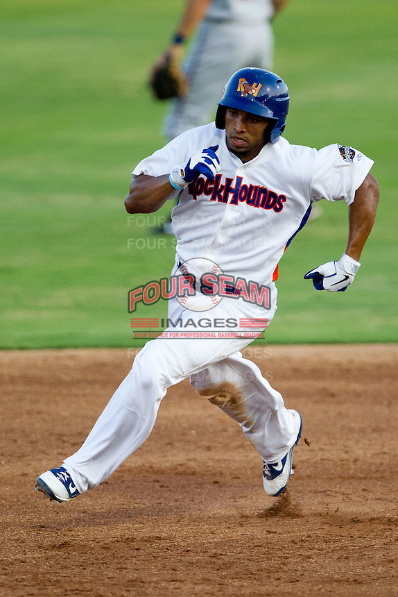 Jermaine Mitchell (25) of the Midland Rockhounds rounds second base during a game against the North All-Stars 2011 in the Texas League All-Star game at Nelson Wolff Stadium on June 29, 2011 in San Antonio, Texas. (David Welker / Four Seam Images)..