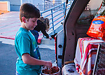 Susan Smith and her son Daniel prepare bowls of food for some of the Rivertown Cats in Antioch, California on Friday, March 21, 2014.  Photo/Victoria Sheridan