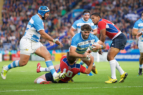 11.10.2015. King Power Stadium, Leicester, England. Rugby World Cup. Argentina versus Namibia. Namibia fly-half Theuns Kotze tackles Argentina flanker Juan Martin Fernandez Lobbe.