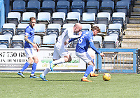 Michael Doyle shielding the ball from Ross Campbell in the SPFL Ladbrokes Championship Play Off semi final match between Queen of the South and Montrose at Palmerston Park, Dumfries on  11.5.19.
