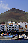 Puerto de La Restinga, Resort and fishing port, with volcanic cone in the background..El Hierro, Canary Islands, Spain.