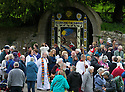 14/05/15<br /> <br /> The clergy members bless Hall Well - the village's main well situated opposite Tissington Hall. This year showing a Biblical design based on Elijah and the Ravens.<br /> <br /> To mark ascension day this year's well dressings are unveiled and blessed by the local clergy in the Derbyshire village of Tissington in the Peak District National Park.<br /> <br /> Before today's blessings, wooden boards coated in clay are decorated with tens of thousands of petals, leaves and pieces of foliage to create the giant intricate mosaics. The boards,  take teams of many villagers three days to make. <br /> <br /> The village has been decorating its six wells every year for more than six hundred years. The tradition is believed to be a celebration of the wells never running dry, giving life and  sustaining the village during times of plague. After a church service today (Thursday)  clergy from six parish will bless each of the well.  <br /> <br /> Following in Tissington's footsteps many other villages in the Derbyshire area also have their own well dressing traditions.<br /> <br /> <br /> All Rights Reserved: F Stop Press Ltd. +44(0)1335 418629   www.fstoppress.com.