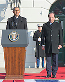 United States President Barack Obama makes remarks as President Francois Hollande of France listens during the State Arrival ceremony on the South Lawn of the White House in Washington, D.C. on Tuesday, February 11, 2014.<br /> Credit: Ron Sachs / CNP
