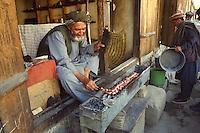 Man cooking kebab