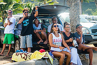 North Shore, Oahu, Hawaii (Sunday, Dec. 1, 2013) .The Moniz family watching son Isaiah Moniz (HAW) on the first day of the contest.-- Hawaii's own Ezekiel Lau, 20, posted the largest victory of his young career today by winning the prestigious 39th annual VANS World Cup of Surfing at Sunset Beach - the second stop of the Vans Triple Crown of Surfing. Lau's win earned him $40,000 and sees him close the year at 35th position on the ASP world rankings. While that doesn't qualify him for next year's elite World Championship Tour, it does guarantee him an excellent seed. He also holds a shared lead on the coveted Vans Triple Crown series rankings with Michel Bourez (PYF) heading into the third and final event of the series - the Billabong Pipe Masters, where he is a local wildard entry.<br /> <br /> Lau made a late tube-riding charge from behind to turn the tables on Damien Hobgood (USA) and Raoni Monteiro (BRA) in the latter half of the 30-minute final. Fourth place was Frederico Morais, (PRT), who was announced the JN Chevrolet Rookie of the 2013 Vans Triple Crown. Lau went on the hunt and found his way onto the biggest waves of the final that also offered high-scoring tube riding potential. His final scoreline was 15.5 points out of 20 (8.67 and 6.83 point rides). Hobgood was second on 14.3; Monteiro third with 12.33, and Morais on 7.16.Photo: joliphotos.com