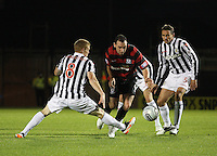 Michael Moffat between Jon Robertson (left) and Lee Mair in the St Mirren v Ayr United Scottish Communities League Cup match played at St Mirren Park, Paisley on 29.8.12.