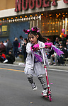 Nalani Aguilar, 5, plays on her new scooter before the start of the annual Nevada Day parade in Carson City, Nev. on Saturday, Oct. 29, 2016. <br />