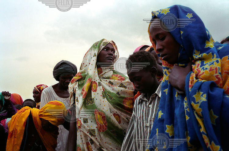 Internally Displaced People (IDP) collecting water at a well in Muhadjeria, south Darfur.