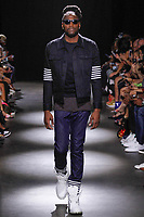 NBA Denver Nuggets forward Kenneth Faried walks runway in an outfit from the Grungy Gentleman Spring Summer 2018 collection by Jace Epstein in the Dream Downtown hotel on July 13, 2017; during New York Fashion Week: Men's Spring Summer 2018.